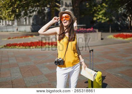 Joyful Traveler Tourist Woman In Orange Heart Glasses With Suitcase City Map Retro Vintage Photo Cam