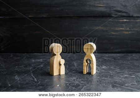 Wooden Figurine Of A Mother With A Void In The Shape Of A Child Looks With Envy At The Mother With T