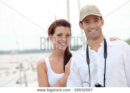 Nice couple walking down the marina.