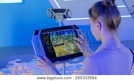 Woman Using Interactive Touchscreen Display With Virtual Map Of Moscow At Modern Technology Show