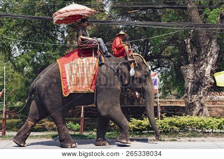 Ayutthaya, Thailand - February 5, 2018: Tourists On An Elephant Ride Tour Of The Ancient City Ayutth