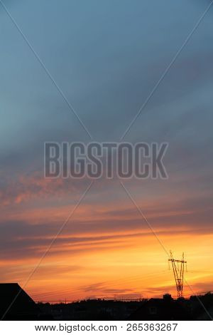 Beautiful Sunset. Blurred Shot Of The Dramatic Sunset On Steppe. Dramatic Clouds As A Defocused Natu