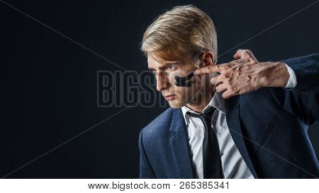 Businessman With War Paint On His Face. Risk Management Concept. Young Guy In Suit With Tie Is Prepa