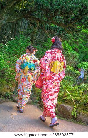 Kamakura, Japan - April 23, 2017: Two Women Wearing Japanese Classic Pink Kimonos Visiting The Green