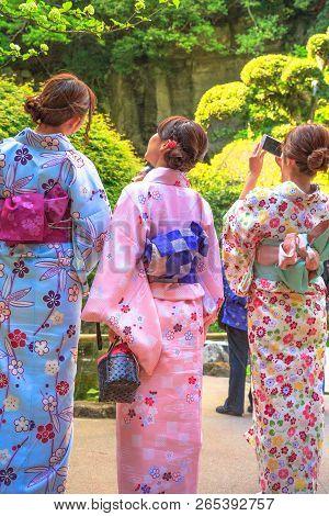 Kamakura, Japan - April 23, 2017: Back Of Japanese Ladies In Zen Garden, Dressed In Traditional Pink