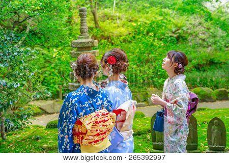 Kamakura, Japan - April 23, 2017: Three Women Wearing In Traditional Japanese Kimono Inside Take-der