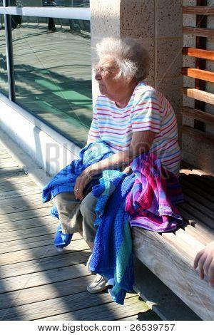 Pensive Senior Woman On Bench