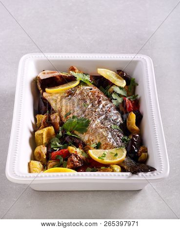 Gilt-head (sea) bream fish baked with vegetables poster