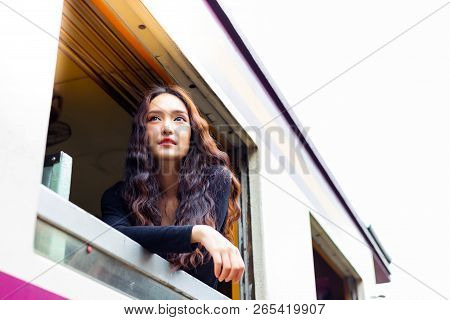 Charming Beautiful Woman Is Looking And Admiring Beautiful View During Retro Train Running And Takin