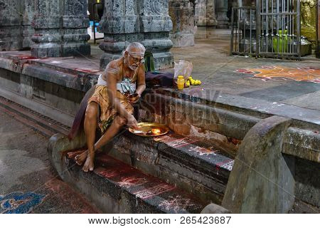 Kanchipuram, India - August 19, 2018: A Brahmin Sitted On Steps Perform An Hindu Ritual  Inside The