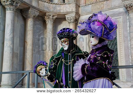 Colorful Carnival Lilac-green-black Mask And Costume At The Traditional Festival In Venice, Italy