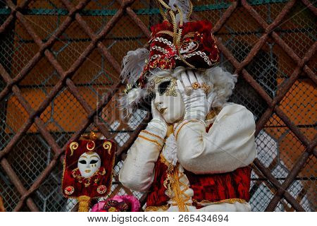Colorful Carnival Red-gold Mask And Costume At The Traditional Festival In Venice, Italy