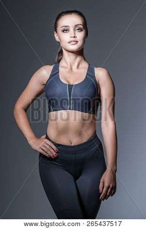 Beautyfull Fitness Woman In Black At The Studio