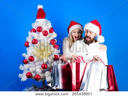 Christmas Presents. Christmas Time. Happy Family Couple In Sweaters&santa Hats Holds Gifts Or Presen