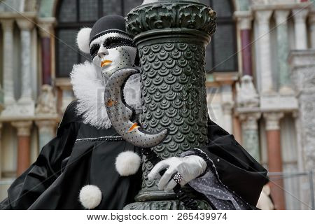 Colorful Carnival Black-white Mask And Costume At The Traditional Festival In Venice, Italy
