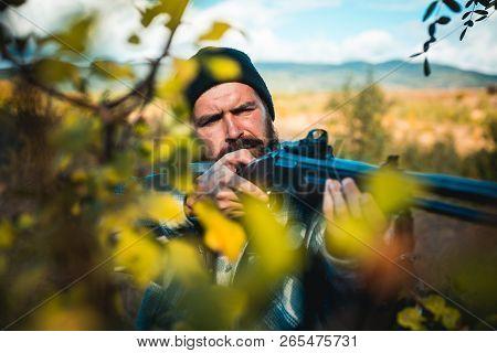 Close Up Snipers Carbine At The Outdoor Hunting. Man Holding Shotgun. Hunter With Shotgun Gun On Hun