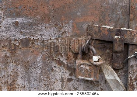 Texture Of Vintage Aged Dirty Rusty Rough Surface Metal Wall And Old Lock Background
