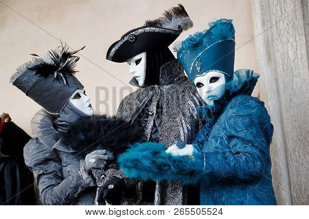 Colorful Trio Carnival Black-blue Mask And Costume At The Traditional Festival In Venice, Italy