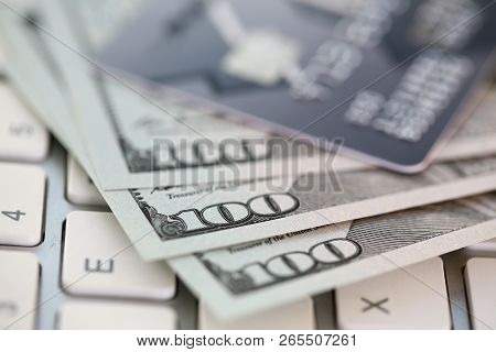 Embossed Chipped Credit Card Lying On Silver Keyboard Closeup. Retail Sale Funds Savings Atm Stash D