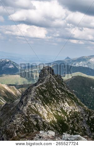 Sharp Ostry Rohac With Giewont On The Background From Placlive Peak On Rohace Mountain Group In West