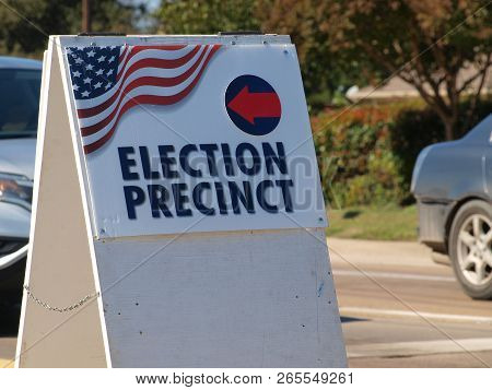 A Voting Location Placard With Directional Arrow.
