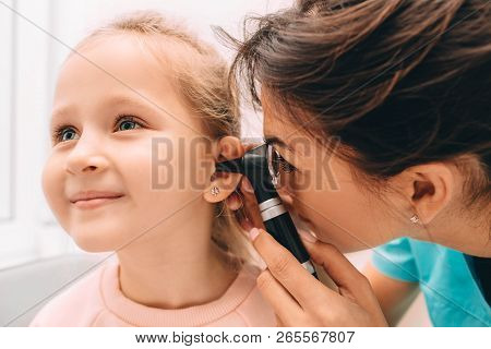 Smiling Little Girl Having Ear Exam With Otoscope