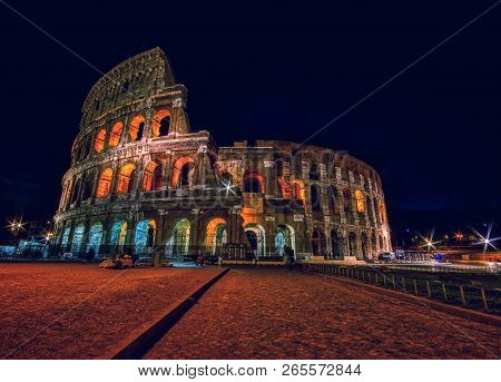 Night View Of The Colosseum Illuminated In Rome.