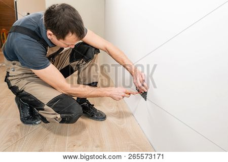 One Electrician Worker At Wiring Cable And Light Switch Or Power Wall Outlet Socket Installation Wor