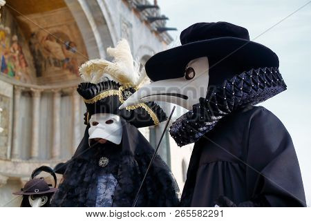 Carnival Black-white Mask And Costume At The Traditional Festival In Venice, Italy