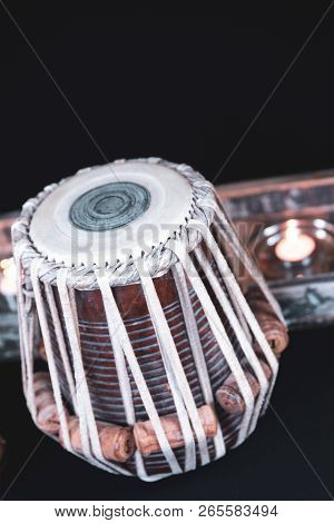 Tabla - Indian classical drums - in an ornate gold setting, with cymbals, jewels and rustic objects