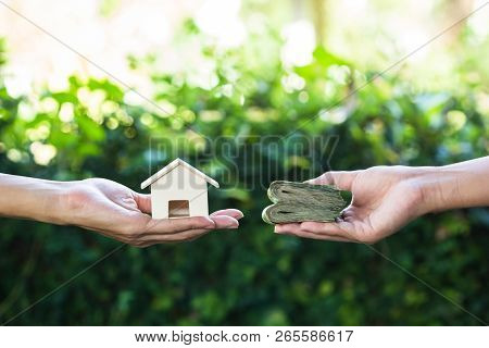 Home Loan, Lending, Mortgage, Transforming Assets Into Cash Concept : Hand Holding Home Model Change