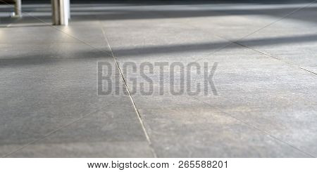 On The Floor The Suns Rays. The Shine Of Sunlight On Pressed Sandstone Paving Slabs Is An Unusual Pe