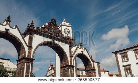 Portas Da Cidade To The Village Of Ponta Delgada In Azores, Portugal. Entrance Gates And The Clock T