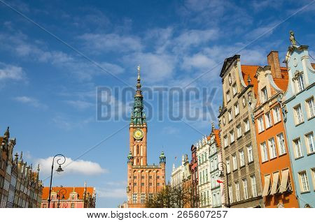 City Hall With Spire, Clock Tower, Facade Of Beautiful Typical Colorful Multicolored Houses Building