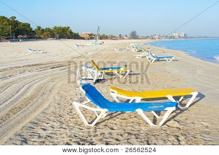 Desrted beach full of chairs