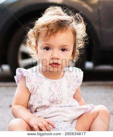 Portrait of a beautiful Toddler girl. Outdoor picture of a beautiful curly-headed child