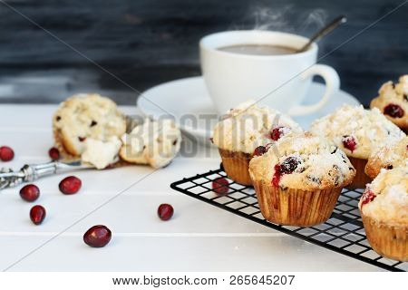 Cranberry Muffins Cooling On A Bakers Rack With Extreme Shallow Depth Of Field And Open Muffin With