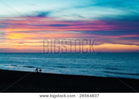 Beautiful sunset or sunrise at a tropical beach with a golden sky