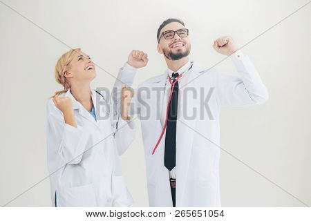 Happy Doctor Celebrates Success With Partner.