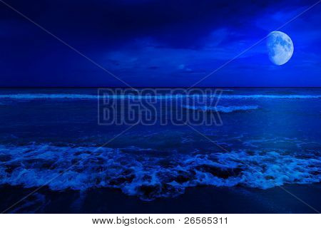 Night scene in a deserted beach with a crescent moon