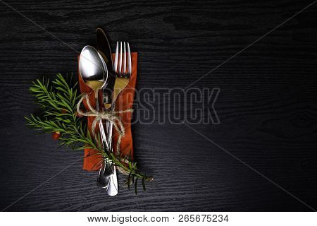Winter Holiday Dinner Plate Decoration On Black Wood Background. Table Set With A Winter, Christmas
