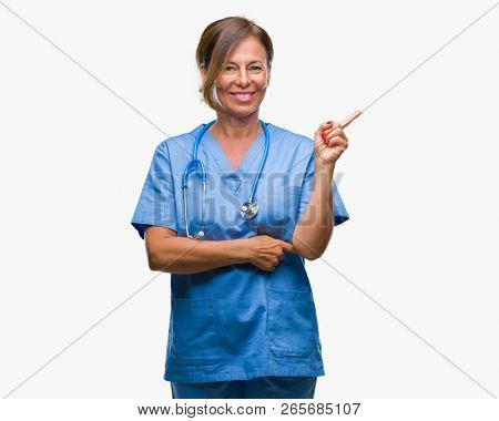 Middle age senior nurse doctor woman over isolated background with a big smile on face, pointing with hand and finger to the side looking at the camera.