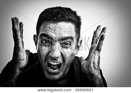Dramatic black and white image of a man yelling with a violent or desperate face