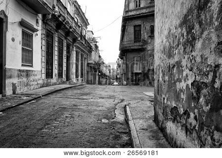 Gritty black and white image of an old street in Havana