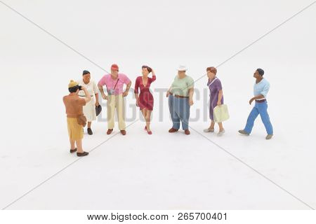 A Group Of Travel Figure On Stand