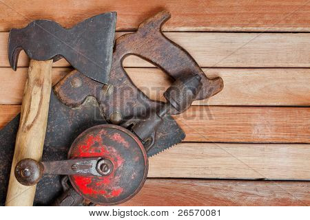 Manual tools over wooden boards with space for text