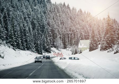Car Driving On A Winter Road In The Mountains