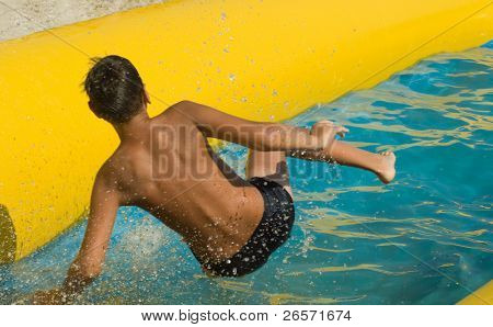 boy on water slide at a vacation resort