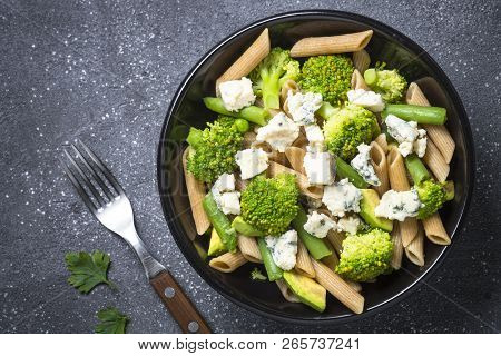 Whole-grain Pasta Penne With Broccoli, Avocado, Green Beans, Peas And Dorblu Cheese. Top View With C