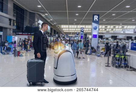 Smart Robotic Technology Concept, The Passenger Follow A Service Robot To A Counter Check In In Airp